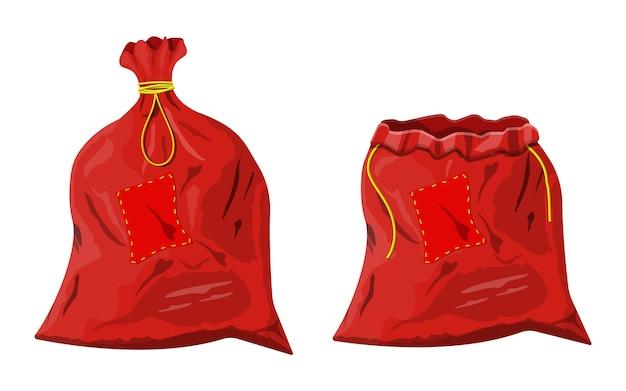 Sac en tissu rouge fermé et ouvert. sac de noël en toile pour cadeaux. décoration de bonne année. joyeuses fêtes de noël. célébration du nouvel an et de noël.