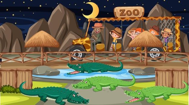 Safari de nuit avec de nombreux enfants regardant un groupe d'alligators
