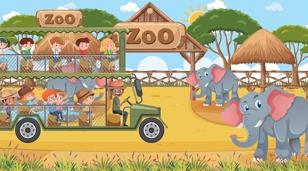 Safari sur scène de jour avec des enfants regardant un groupe d'éléphants