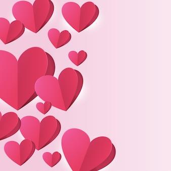 La saint-valentin. aime le fond rose. papier coeur coupé et retourné.