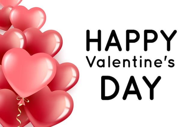 La saint-valentin avec des ballons en forme de coeur rouges et roses et place pour le texte. la saint-valentin
