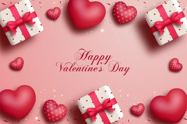 Saint valentin avec boîte-cadeau avec ruban rouge et ballon d'amour.