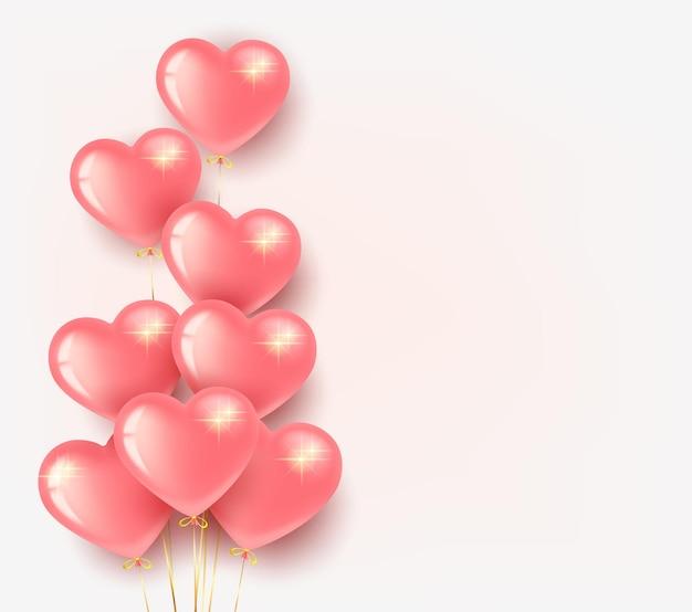 Saint valentin, lot de ballons roses en forme de coeur. sur fond clair.