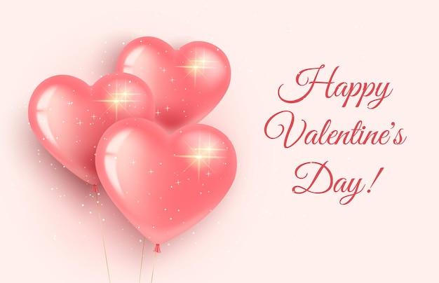 La saint-valentin. trois ballons roses en forme de cœur avec des paillettes.
