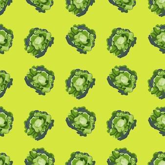 Salade de butterhead modèle sans couture sur fond vert clair. ornement simple avec de la laitue. modèle de plante géométrique pour le tissu. illustration vectorielle de conception.