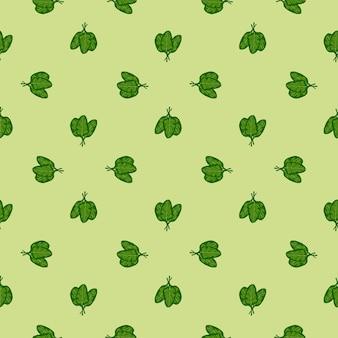 Salade d'épinards de bouquet de modèle sans couture sur le fond vert clair. ornement minimaliste avec de la laitue.