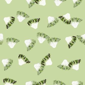 Salade frisée de modèle sans couture sur fond vert pastel. ornement abstrait avec de la laitue. modèle de plante aléatoire pour le tissu. illustration vectorielle de conception.