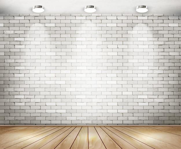 Salle de briques blanches avec des projecteurs.