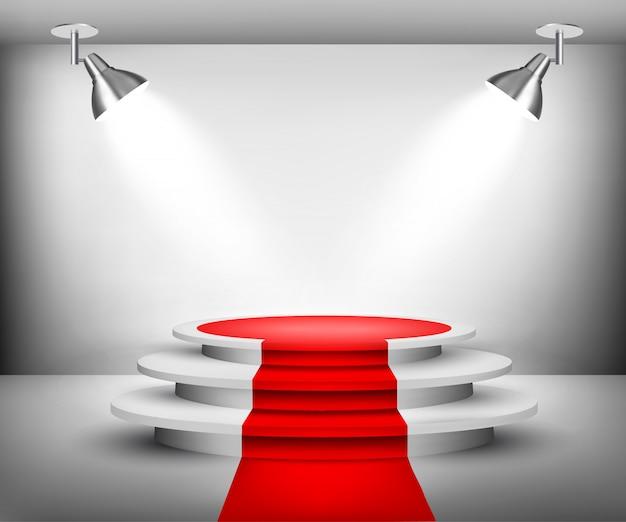 Salle d'exposition avec tapis rouge.