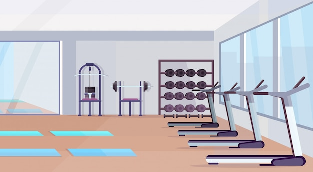 Salle de fitness studio équipement d'entraînement concept de mode de vie sain vide pas de personnes salle de gym intérieur avec tapis appareils d'entraînement haltères miroir et fenêtres horizontales