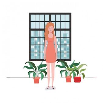 Salon femme avec vue sur la ville par la fenêtre