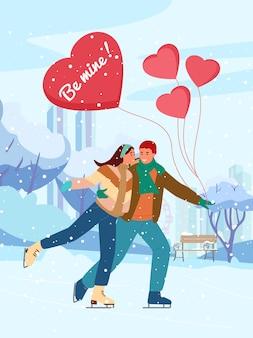 Salutations de la saint valentin. couple amoureux du patinage sur glace dans le parc d'hiver avec des ballons en forme de coeur sous les chutes de neige.