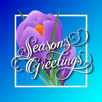 Salutations de saisons lettrage avec snowdrop dans le cadre sur fond bleu.
