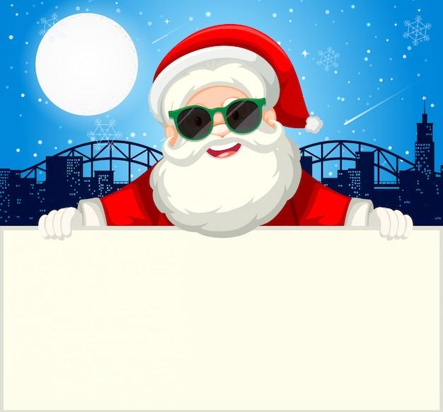 Santa tenant le concept de papier ordinaire