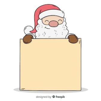 Santa tenant une pancarte blanche