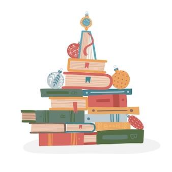 Sapin fait de tas de livres pour les festivals de livres de noël ou les ventes de librairies design créatif...