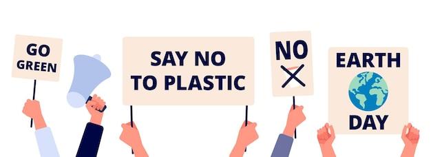 Sauver l'environnement. jour de la terre, passez au monde vert et écologique. mains tiennent des affiches d'écologie, sauvant les bannières de la planète
