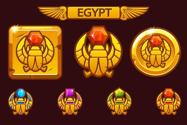 Scarabée égyptien symbole du pharaon avec des pierres précieuses colorées. icônes égyptiennes