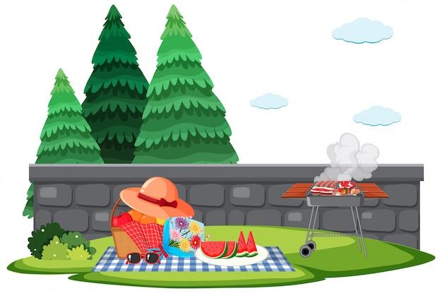 Scène avec barbecue et panier pique-nique dans le jardin
