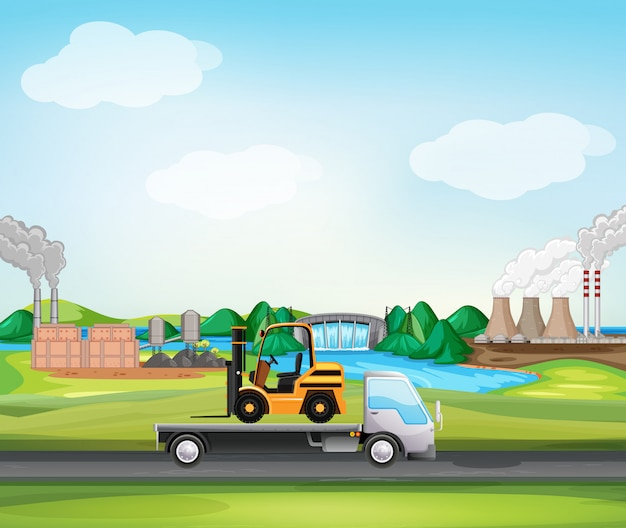 Scène avec camion roulant le long de la zone industrielle
