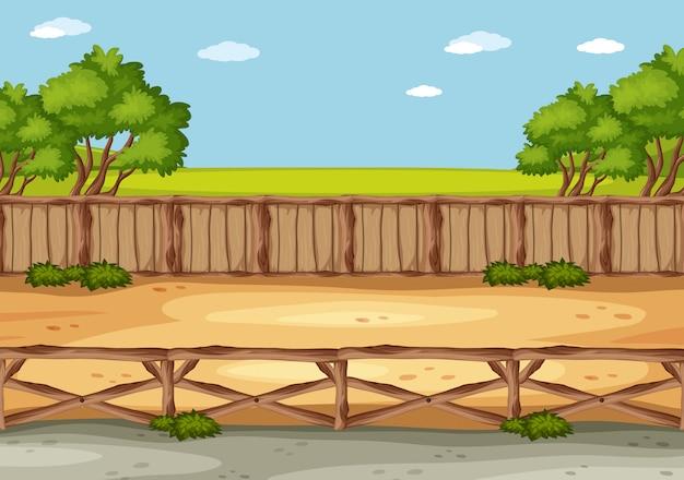 Scène avec champ vert et clôture le long de la route