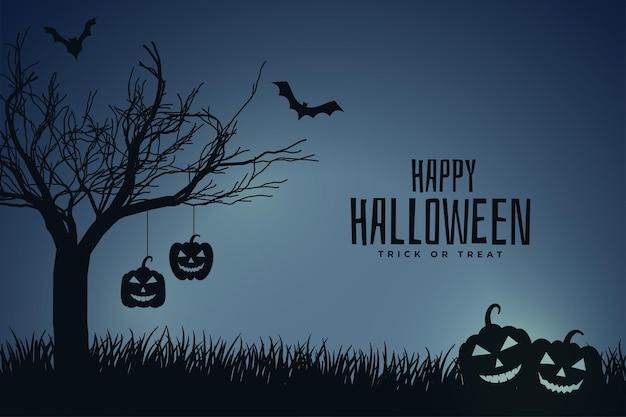 Scène effrayante d'halloween de nuit avec citrouille et arbre