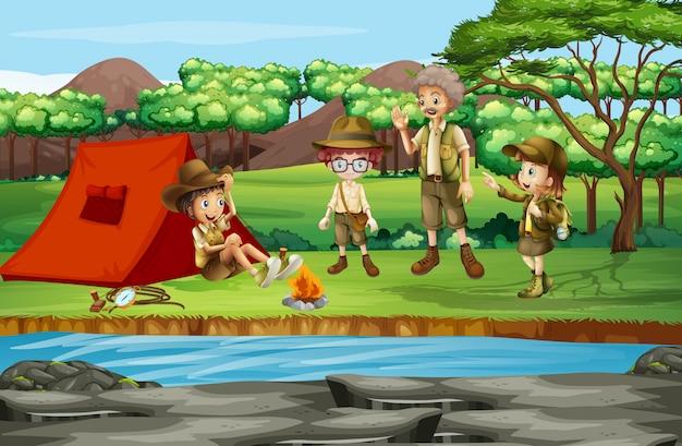 Scène avec des enfants en camping au bord de la rivière