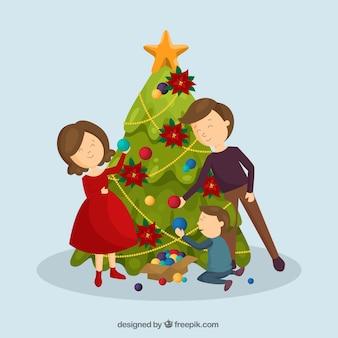 Scène de famille mignon avec arbre de noël