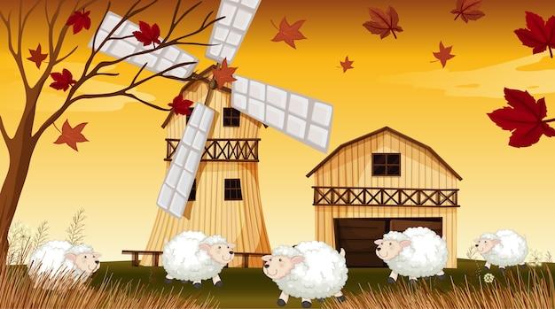 Scène de ferme dans la nature avec grange et moulin à vent et moutons en saison d'automne