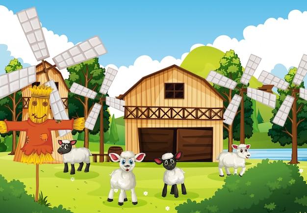 Scène de ferme dans la nature avec grange et moulin à vent et moutons