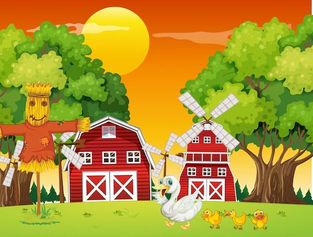 Scène de ferme dans la nature avec grange et moulin à vent et petit canard