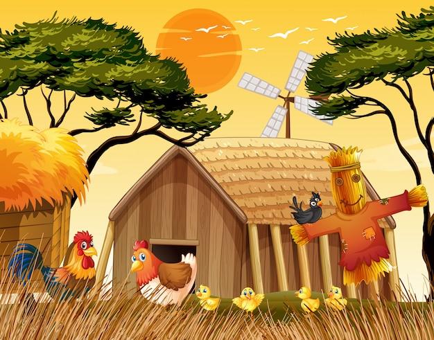 Scène de ferme dans la nature avec grange et moulin à vent et poulet