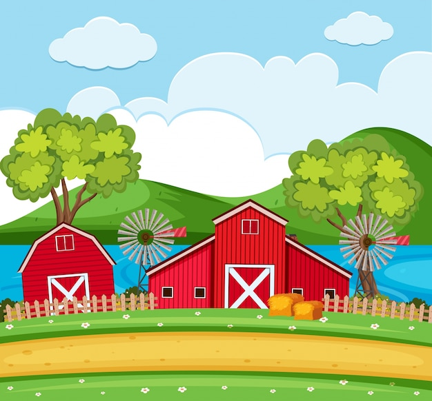 Scène de ferme avec des granges rouges et des éoliennes