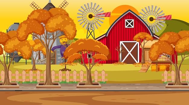 Scène de ferme vide au coucher du soleil avec grange rouge et moulin à vent