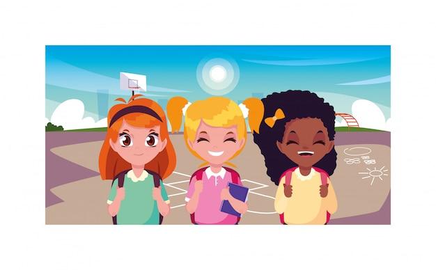 Scène de filles souriant dans le parc, retour à l'école