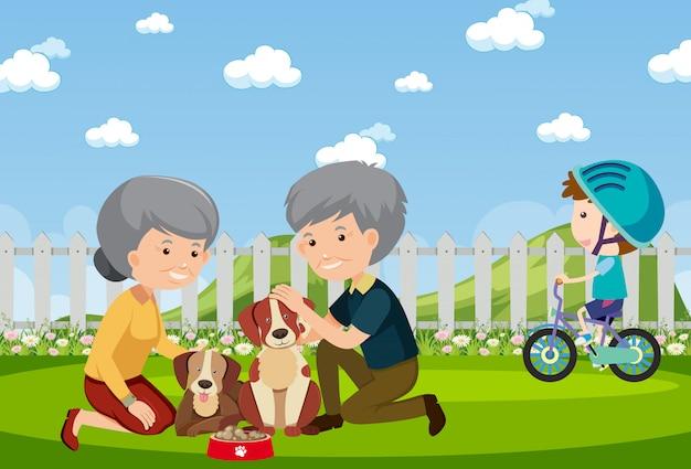 Scène de fond avec des gens et des chiens dans le parc