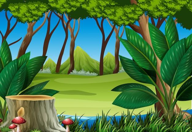 Scène de la forêt avec souche arbre et montagnes