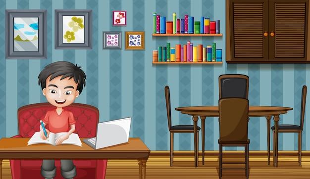 Scène avec garçon travaillant sur ordinateur à la maison