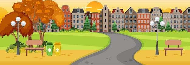 Scène horizontale au coucher du soleil avec une longue route à travers le parc jusqu'à la ville