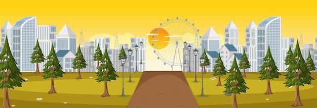 Scène horizontale avec une longue route à travers le parc jusqu'à la ville à l'heure du lever du soleil