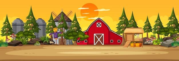 Scène horizontale des terres agricoles avec grange et moulin à vent au coucher du soleil