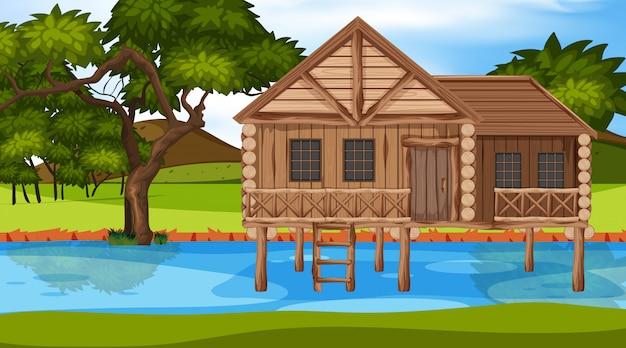 Scène avec maison en bois dans la rivière