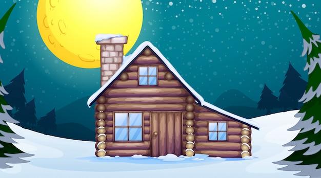 Scène avec maison en bois en hiver