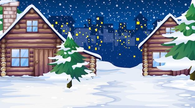 Scène avec des maisons dans la neige