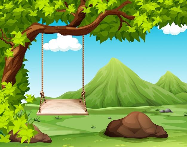 Scène de la nature avec balançoire sur l'arbre
