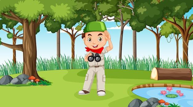 Scène de la nature avec un personnage de dessin animé de garçon musulman explorant dans la forêt