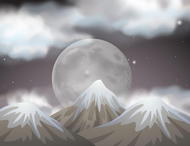 Scène de la nature avec la pleine lune derrière les montagnes