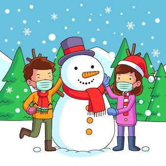 Scène de neige de noël avec la famille portant des masques