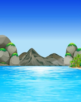 Scène d'océan avec des montagnes et des arbres