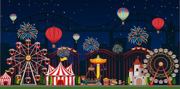 Scène de parc d'attractions la nuit avec des ballons et des feux d'artifice